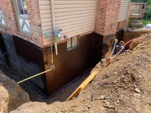 Foundation being Waterproofed